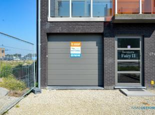 Res. Fairy II, deze ruime garagebox (l: 5.42m x b: 2.87m) is volledig voorzien van alle uitrusting: automatische Hörmann-poort voorzien van codek