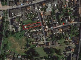 Perceel grond met een oppervlakte van 407 m² in het centrum van Zelzate. Op deze grond zijn op heden 7 individueel afsluitbare garageboxen voorzi