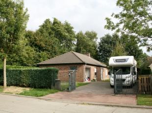 Deze laagbouwwoning is gelegen in een residentiële verkaveling in Sleidinge.<br /> Dankzij de uitstekende ligging geniet u enerzijds volop van ru