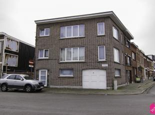 Deels te renoveren woonhuis, thans in gebruik als opbrengsteigendom (garage met koer op de gelijkvloerse verdieping en op de eerste en de tweede verdi