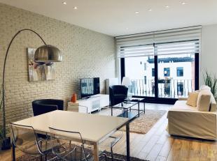 Modern en volledig gemeubeld appartement op de derde verdieping van een kleinschalige realisatie op een werkelijke toplocatie op het hippe Eilandje.<b