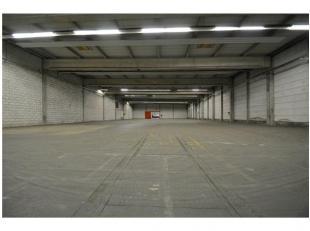 AFMETINGEN: 38,72m x 25,56mBESTAANDE TOESTAND: Een solide, betonnen constructie met grote overspanning - betonnen vloer - volledig vernieuwd en ge&ium