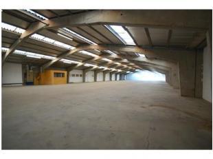 INDELING:Magazijn (1.120m2) - kantoor (145m2): inkom met toegangsdeur naar magazijn, ruim bureel, toilet, ontvangst - en vergaderruimte, landschapsbur
