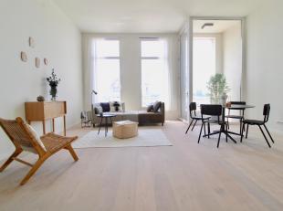 Hedendaags volledig gerenoveerd appartement (ca.98m²) met frontaal uitzicht op de Schelde in een monumentaal gebouw op het Eilandje. Verkoop onde