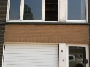 rustig gelegen woning met garage en tuin<br /> Indeling : benedenverdieping : inkomhall, toilet, garage voor 1 auto, terras, tuin met tuinhuis, bergin