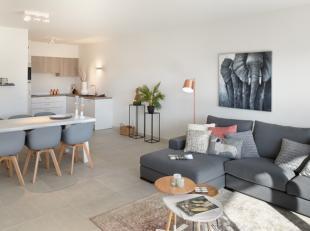 Dit appartement heeft een lichtrijke leefruimte, vooraan zicht op een binnentuin en achteraan op het gloednieuwe park in de nieuw aangelegde stationsb