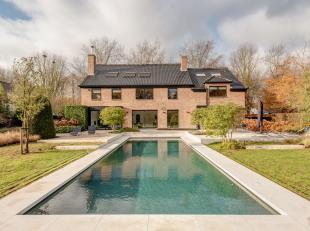 """Deze trendy, luxueuze villa met een bewoonbare oppervlakte van 535 m² is gelegen op een absolute toplocatie in de residentiële wijk """"De List"""