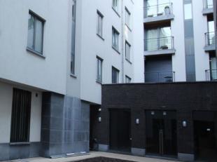 Splendide appartement de +- 120m² situé au premier étage dun immeuble récent est composé comme suit : hall dentr&eacu