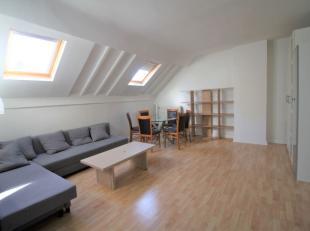 Quartier Schuman - Magnifique appartement 1 chambre meublé de +/-65m² se composant comme suit: Hall d'entrée - Lumineux living de +
