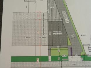 Interessant gelegen bouwgrond van 4 are 80 in KMO zone. Met goedgekeurde plannen voor het bouwen van een werkplaats met toonzaal, appartement voor hui