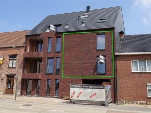 Mooi nieuwbouw duplex-appartement met alle comfort en een terras gelegen te Hoegaarden, Ernest Ourystraat 30 Bus 3, totale oppervlakte van 115 m2. Op
