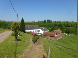 A 10' de Nivelles, endroit magnifique au fond d'une impasse avec vue sur la campagne environnante, authentique ferme en carré de 1792 sur +/- 1