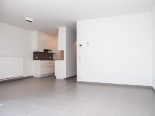 Un appartement neuf construit dans le centre avec deux chambres et une terrasseEntrée, séjour ouvrant sur terrasse, cuisine aména