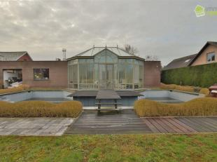 Luxueus uitgeruste villa gelegen in een residentiële woonwijk te Dendermonde (Baasrode) Deze stijlvolle open bebouwing heeft maar liefst een tota