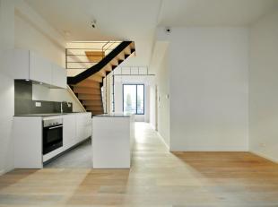 In het hart van Brussel: Mooi nieuw appartement van ± 89m². Lichte leefruimte met balkon en volledig uitgeruste Bulthaup-keuken. Slaapkame